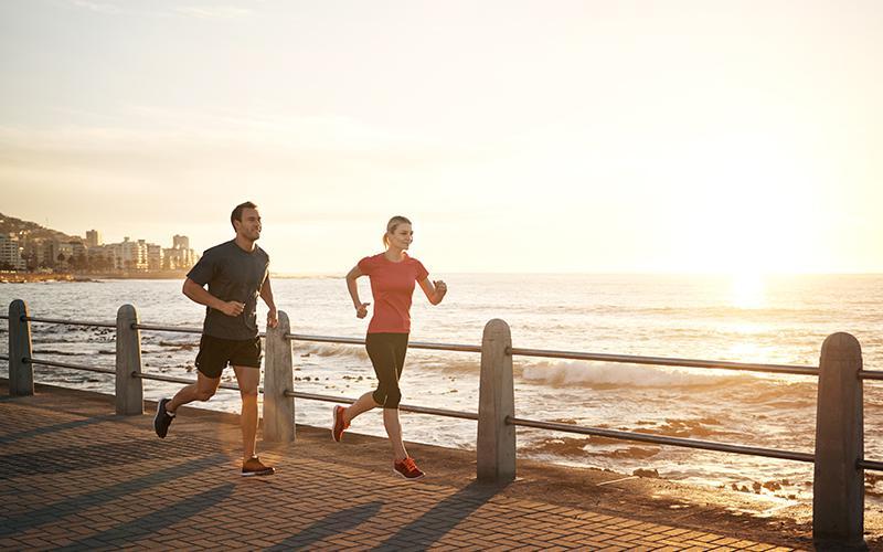 runners at beach